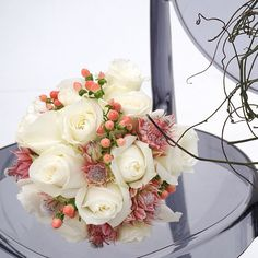 Rose, blushing bride and hypericum bouquet.