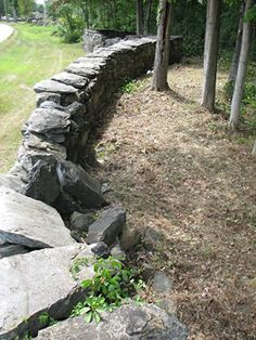 stone wall....love....I want one to separate my formal backyard from my meadow.