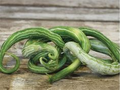 """Snake Melon """"EX Long Snake"""" produces inch fruit with green & white stripes. They reportedly turn red inside and out when more mature! I gotta see that! Seed from Baker Creek Seed. Colorful Vegetables, Organic Vegetables, Fruits And Vegetables, Plants For Raised Beds, Seeds Online, Organic Seeds, Rare Flowers, Garden Seeds, Dream Garden"""