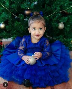 Sapphire dresses in blue dress. Which, Sienna made for her to look very beautiful for our annuale Christmas family photo.