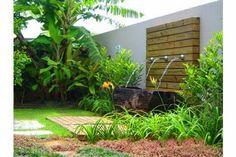 Fonte de água no muro do jardim.  Fotografia: http://www.jeitodecasa.com