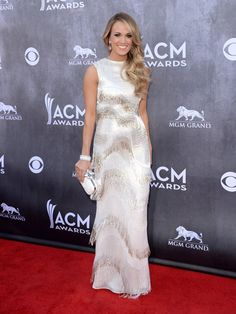 Pin for Later: Who Wore the Sexiest Gown at the ACM Awards? Carrie Underwood The country star chose a fringed gown and David Yurman jewels for the awards.