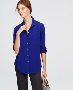 Made from luxe silk in the season's most coveted colors, this wardrobe staple is endlessly polished. Point collar. Long sleeves with button closure. Button front. Front patch pocket. Back yoke with box pleat. Shirttail hem.