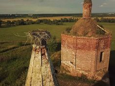 Drone shows abandoned russian church with storks nest on the roof