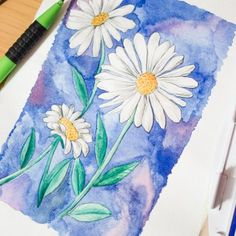 A step-by-step photo tutorial on how to paint daisies with watercolors.