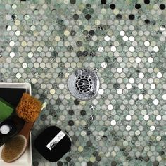 Beautiful combination of marble and glass penny round mosaics. Perfect for a contemporary or modern feel. Shop these tiles and more at TileBar.com!: