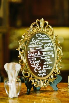 Don't feel like using a chalkboard at the wedding? Buy a beautiful mirror and write on it with a paint marker. Use this detail to display the drink choices for the wedding reception cocktail hour.