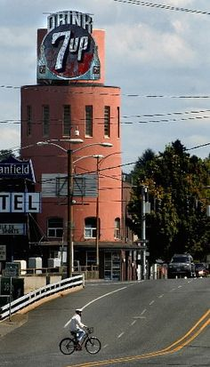 Drink 7-up sign, NE Portland, in the Hollywood District.  It was there for the longest time, but I think it's not there anymore.  The sign, when lit up, would show the bubbles, going up the bottles on each sign.