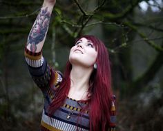 red hair girl with forearm tattoo