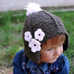 This hat pattern is sized for a 12-18 month old toddler.  For a boy, just leave off the picot trim and flowers.
