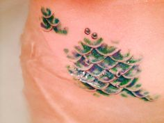 New photo of my mermaid scales all healed(: