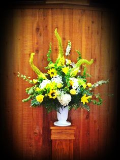 These were placed on each side of the Alter. The arrangement was made with White Larkspur, Edmeades, Yellow Asiatic Lilies, Bells of Ireland, Sunflowers, Yellow Roses, White Hydrangeas and Green Spider Mums www.flowersfromus.net