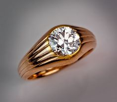 #Fabergé  --   Diamond Solitaire Gold Ring  --  Circa 1900  --  A simple, yet elegantly designed, reeded 14K gold ring is set with a sparking old European cut diamond.  Reeded patterns were frequently used by Peter Carl Faberge.  The recently discovered Third Imperial Fabergé egg is also of a reeded pattern. Faberge rings are extremely rare in general.  Moreover, rings with large diamonds are particularly rare.  Via Romanov Russia