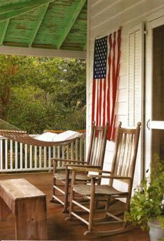 Maybe a flag on the porch and a rustic bench and a rocker.