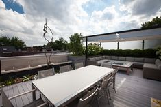 This trendy and chic rooftopin Bucktown, Chicago provides a private outdoor living space perfect for relaxing and entertaining. Designed by Chicago Green Design, the custom pergola featuring two sections of 10' wide x 15' long Infinity Canopy in the Phifertex Plus White fabric, makes this an ideal rooftop retreat.