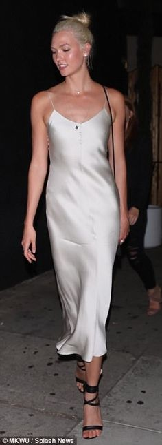 Karlie Kloss shows off svelte figure in silk silver dress | Daily Mail Online
