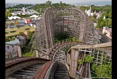 Roller coaster named Aska in abandoned Nara Dreamland amusement park in Japan - trees growing up through the tracks!