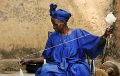 Malian woman spinning yarn