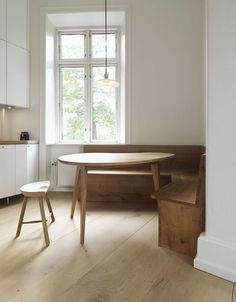 A Copenhagen kitchen features Dinesen Heart Oak furniture (and floors) for a built-in booth. See more of the kitchen inRemodeling 101: The L-Shaped Kitchen.