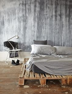 Pallet bed with gray bedding