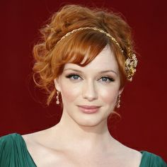 christina hendricks with a hairpiece and updo--such a pretty look.