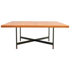 Coffee table size XL in teak and gunplated steel. Designed by Finn Juhl and manufactured by Niels Vodder Cabinetmakers Copenhagen and sold from Illums Bolighus, Danmark, ca.1950's