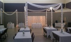 Build your own arches with PVC pipe or empty carpet rolls, tulle, and lights