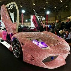The Lamborghini Murcielago finished with pink Swarovski crystals on the whole body. The Lamborghini Murcielago finished with pink Swarovski crystals on the whole body. Carros Lamborghini, Lamborghini Veneno, Pink Lamborghini, Custom Lamborghini, Lamborghini Limousine, Lamborghini Interior, Pink Ferrari, Lamborghini Pictures, Lamborghini Diablo