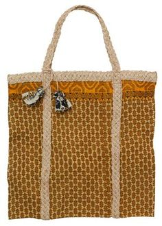 Fair trade bag from People Tree, hand braided jute and lined with recycled sari.
