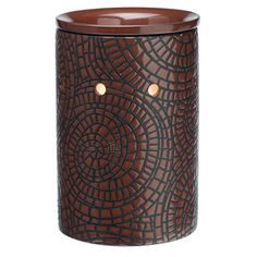 A swirling mosaic of burnished red ochre enhances this simple warmer with the look of cobbled leather.