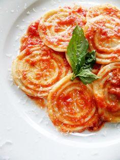 corzetti pasta with sauce