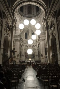 Robert Stadler and his lighting installation in the church of Saint-Paul Saint-Louis in Paris.