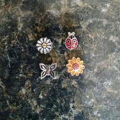 Flowers lady bug butterfly floating locket charms NWOT!! I own a small at home business and am clearing out some stock. Check out my other listings for more floating charms! These are not origami owl brand, but they fit in all lockets. Includes all 4 charms shown. Any questions, just ask! Jewelry