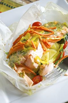 Flaky and tender salmon filets combine with lots of fresh veggies and my basil dressing for a delicious meal baked in parchment paper. It's easy to put together and even easier to clean up! It's already Monday, again! Does anyone else feel like it's always Monday? I must apologize for my lack of posts lastRead more