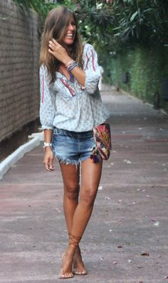 Fashion blogger Mytenida killing it as usual in a boho tunic, denim cut offs, coin cross body & strappy leather sandals.