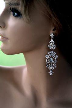 4 inches long Swarovski crystal chandelier earrings (Carlina). $56.00, via Etsy.