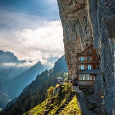 Honeymoon destination of the week: Berggastaus Aescher-Wildkirchli in eastern Switzerland. Accessible only by cable car and hike, this 210-year-old storybook guesthouse and restaurant sits at the northernmost summit of the Appenzell Alps, built into the rocky cliffside. Although the accommodations are spartan, the rooms offer spectacular views, and the eatery is a great spot for savoring local dishes, such as cervat and Appenzeller cheese salad. Photo by Peter Boehi.