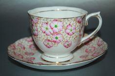 ROYAL ALBERT Crown China Teacup and Saucer Set