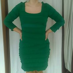 Green Bandage Dress Is a very nice fit. Has a square cut neckline and 3/4 sleeves. Size says L, but I've had XL and S sized friends borrow it. Max Studio Dresses