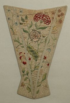 1700-49 .Stomacher - Linen and Whalebone. covered with quilted linen rep embroidered in a floral design in polychrome silk. Backstitched vermicular ground. Edges and flap bound with silk tape and criss-crossed with round lacing cord. p28 Janet Arnold - Patterns of Fashion 1