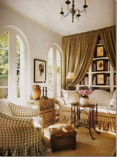 Love the curtains over the book cases..