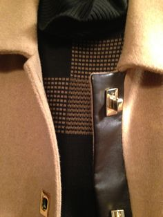 Closure on the Camel Hair Turnlock Coat ~ Metallic turnlocks, of course! Check the unexpected twist ~ a placket in faux leather!