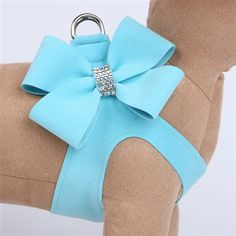 This stunning, blue step in harness by designer Susan Lanci offers the best of the best for your dog including security, comfort and style. The stylish step in dog harness features an oversized Nouveau Bow with a sparkling Swarovski crystal center and is