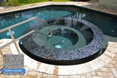 This is a good example of how water depth affects the pool's water color. Hydrazzo Classico Roma Laguna goes from a nice gray finish in the spa to a bluer teal in the deep end. Pool built by Coastal Luxury Outdoors of Ponte Vedra Beach, FL. Plastered by CL Industries Certified Applicator, Tempool Inc. of Jacksonville, FL. #swimmingpool #pool