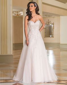 Justin Alexander wedding dresses style 8869 Shine all day long in this embroidered A-line sparkle tulle gown with a sweetheart neckline, hand beaded crystals, pearls and bugle beads throughout the gown completed with a chapel length train.