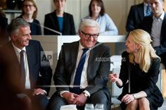 The Foreign Ministers of Switzerland Didier Burkhalter, of Germany Frank-Walter Steinmeier and of Liechtenstein Aurelia Frick, from left, chat after a news conference as part a meeting of German speaking Foreign Ministers in Berlin, Germany, Thursday, Nov. 27, 2014. (AP Photo/Steffi Loos)