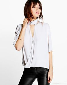Hey hottie! The choker trend is at full throttle and this choker wrap blouse…
