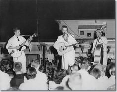 On July 15, 1955, Elvis, Scotty and Bill performed at the Drive-In. They were booked by John Cobb who regularly attended the Louisiana Hayride and had first seen them perform there. For a stage, Cobb borrowed a flatbed truck from Almond's Feed & Seed Co. in Minden and parked it in front of the snack bar (concession stand).  They were said to have been booked for two appearances but only did the one and paid $25 for it. -