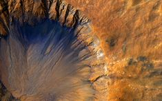 June 5, 2015 The High Resolution Imaging Science Experiment (HiRISE) camera aboard NASA's Mars Reconnaissance Orbiter acquired this closeup image of a 'fresh' (on a geological scale, though quite old on a human scale) impact crater in the Sirenum Fossae region of Mars on March 30, 2015. This impact crater appears relatively recent as it has a sharp rim and well-preserved ejecta. The steep inner slopes are carved by gullies and include possible recurring slope lineae on the equator-facing…