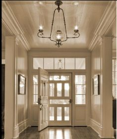 Note that the custom screened door was made to match the solid wood front door.